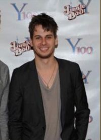 """Miami, FL—Mark Foster of Foster The People, left, recently wore this Edward  Mirell titanium and 18k gold Cable Sport Cross during the """"Jingle Ball""""  concert ..."""